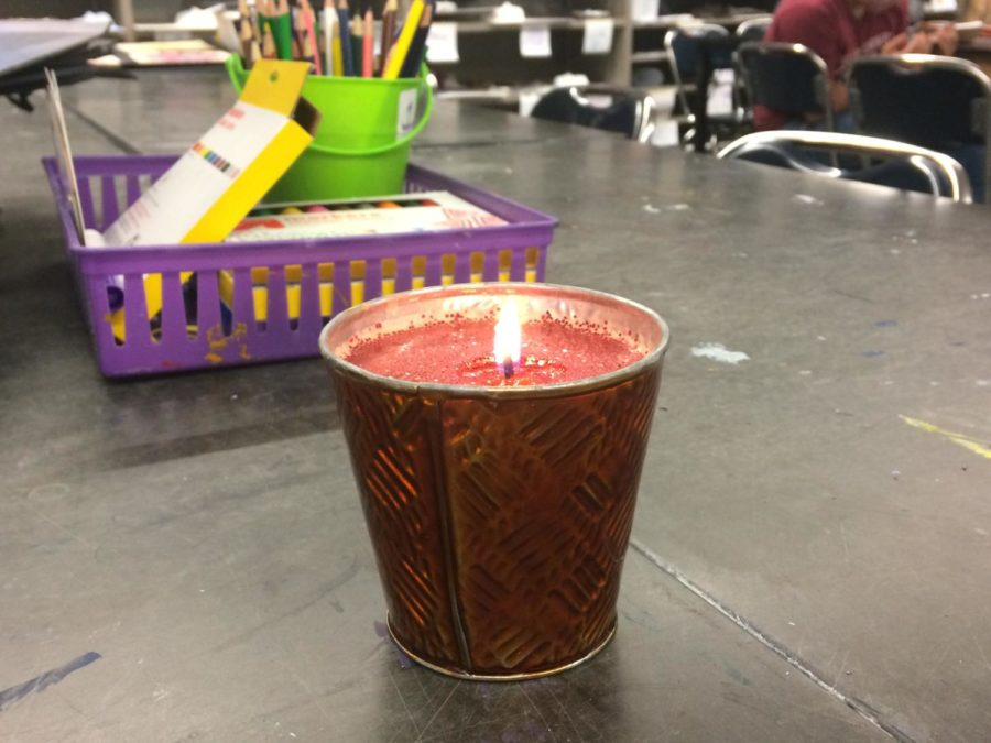 A+candle+that+was+made+in+Art+Club+is+lit+for+everyone+to+see.