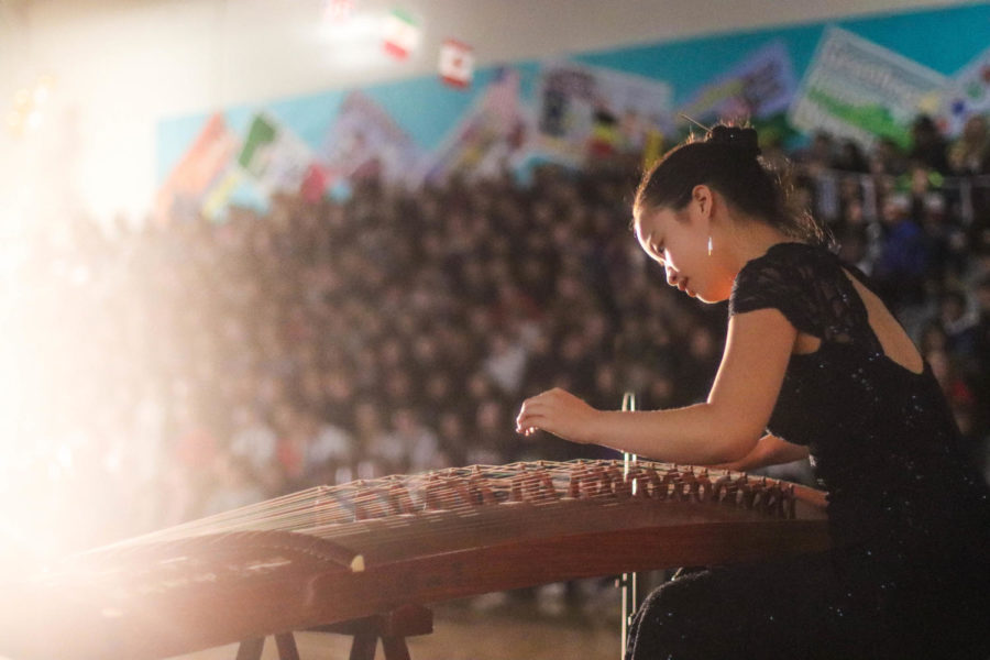 Jocelyn Wang plays the zither for the performance by Chinese Culture Club.