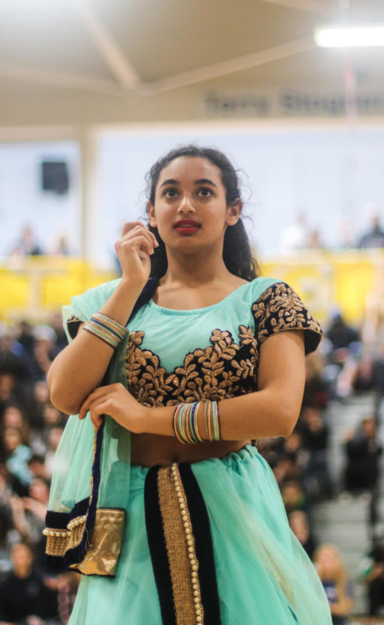 Kinjal Vyas, a junior, dances with Indian Club.