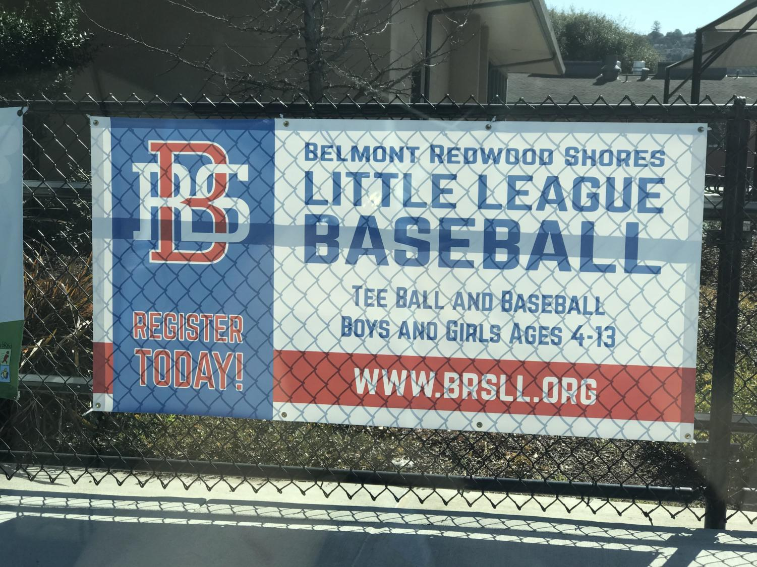 Banner posted in front of baseball field promoting BRSLL baseball.