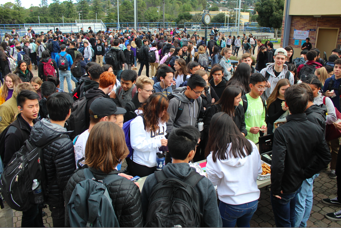 Students wait in front of Filipino Club to buy lumpia, a Filipino version of a fried spring roll.