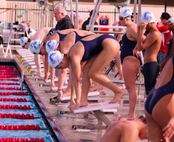 The varsity girls' swim team prepares for a race against the Burlingame Panthers on March 9.