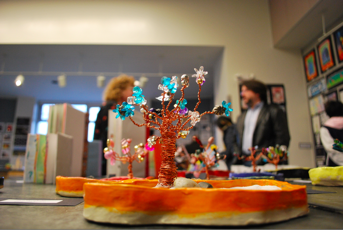 Miniature+gardens+on+display+were+created+by+Ceramics+classes+out+of+clay%2C+wire%2C+and+decorative+beads.