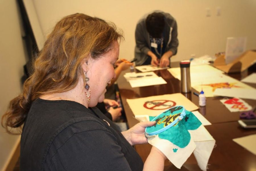 Robin Gadient, the SJSA creative director, embroiders a piece for a student. He wanted graffiti-style letters that said,