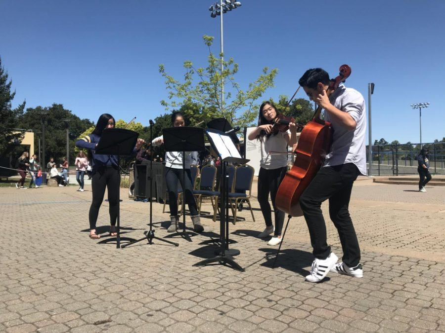 Seniors+Mikayla+Cheng+and+Jason+Liu+were+joined+by+junior+Yannie+Lam+and+sophomore+Selena+Sun+to+perform+in+a+string+quartet.+