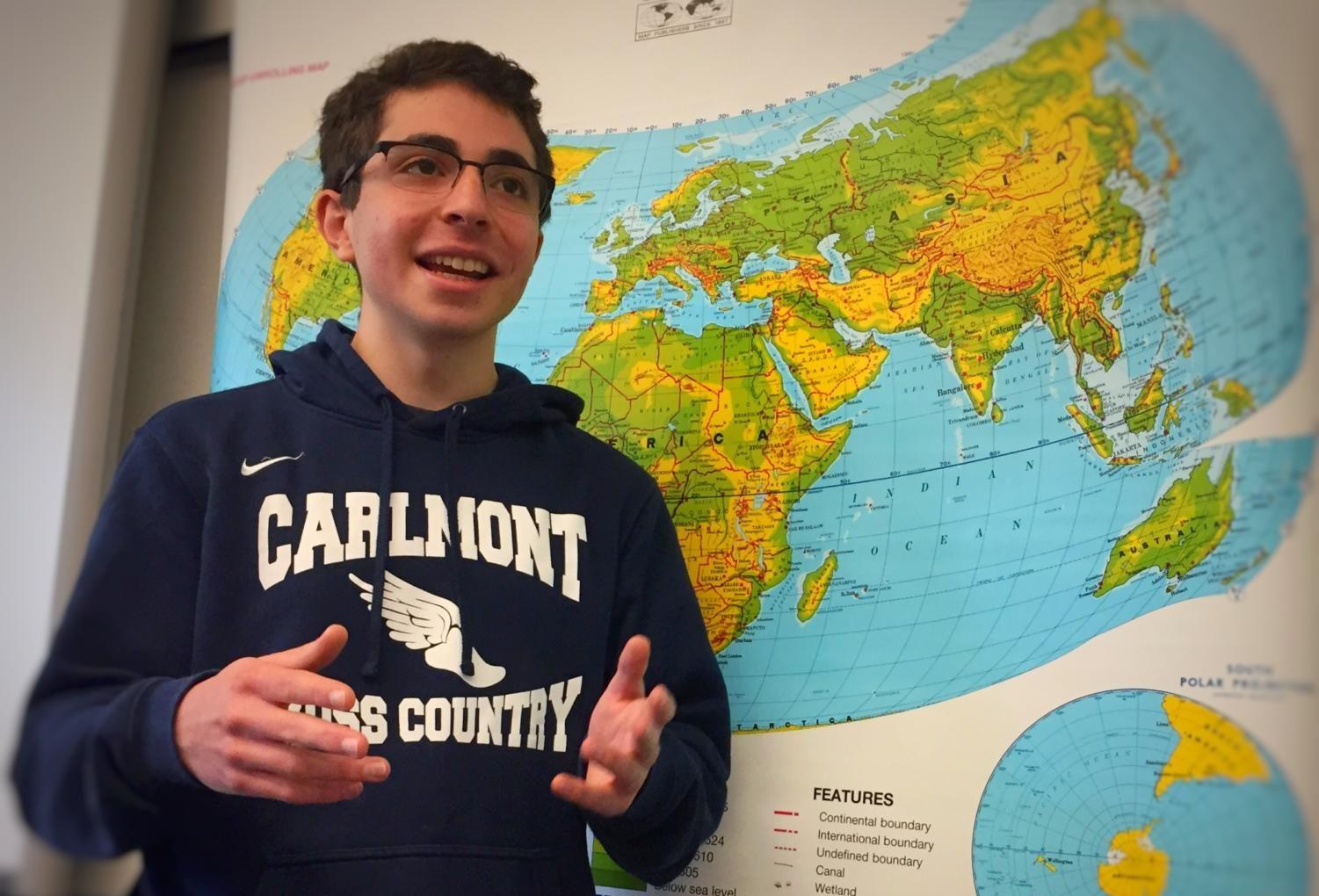Model United Nations Club President Alex Derhacobian gives a presentation on the current global conflicts surrounding politics during one of their regular Monday lunch meetings.