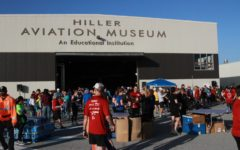 People gather around the Hiller Aviation Museum waiting for the race to take place.