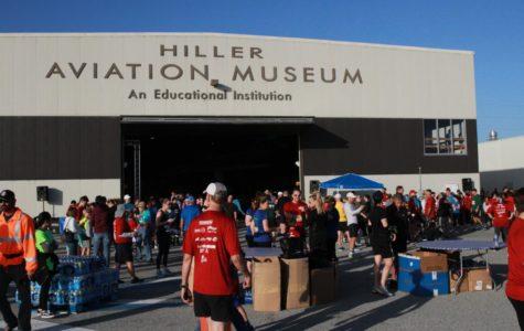 Runners take to the runway at San Carlos Airport