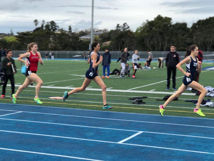 Kaimei Gescuk and Mandy Hitchcock sprint past an Aragon runner in their varsity 800 meter race.
