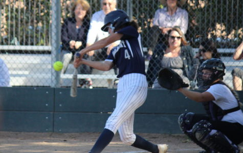 Sophomore Amanda Kondo tries to hit the ball thrown by a Sequoia pitcher.