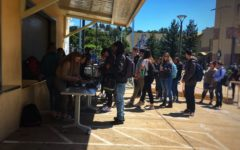 Students eagerly await their turn to purchase tickets for prom in the quad.