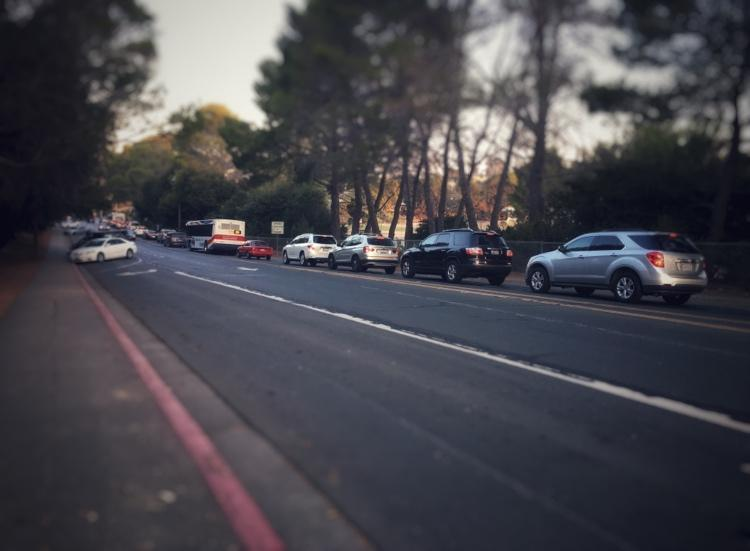 Stopped cars wait endlessly in traffic on Alameda de las Pulgas. When the surrounding schools are released for the day, cars can be stopped all the way from Carlmont Drive to Ralston Avenue.