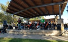 Colyn Fischer introduces the Central Middle School Orchestra during the Hometown Days kickoff event.