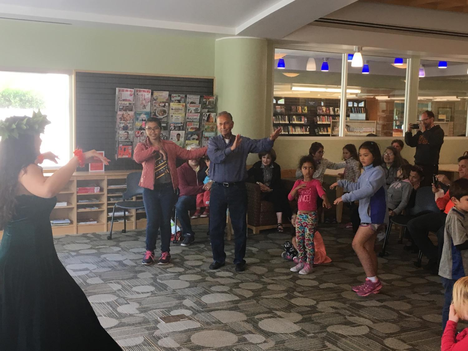Library visitors learn basic hula steps as part of Asian-Pacific Heritage Month.