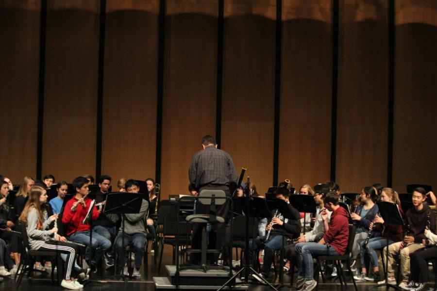 Symphonic Band rehearses in the Performing Arts Center before their performance.