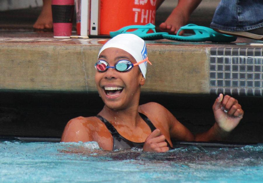 Freshman+varsity+swimmer+Morgan+Hawes+looks+at+the+scoreboard+in+surprise+after+placing+second+in+the+200-yard+freestyle+and+swimming+a+PR+of+1%3A51.80.+Hawes+also+went+on+to+break+Carlmont+varsity+records+for+her+200+individual+medley+%28IM%29%2C+100+free%2C+and+500+free.+She+qualified+for+eight+events+at+CCS.