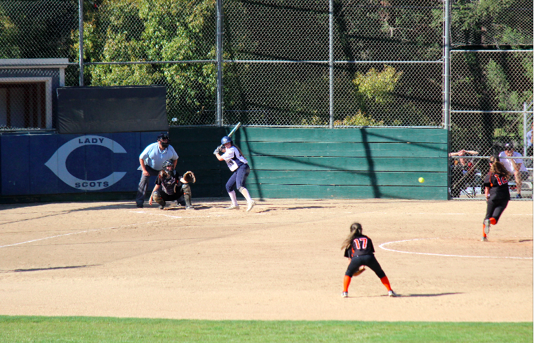 A Carlmont player gets ready to hit an incoming pitch.