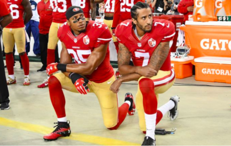 Eric Reid and Colin Kaepernick kneel before a game in 2016.