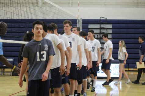 Varsity boys' volleyball wins their game against Hillsdale after going to a fourth set