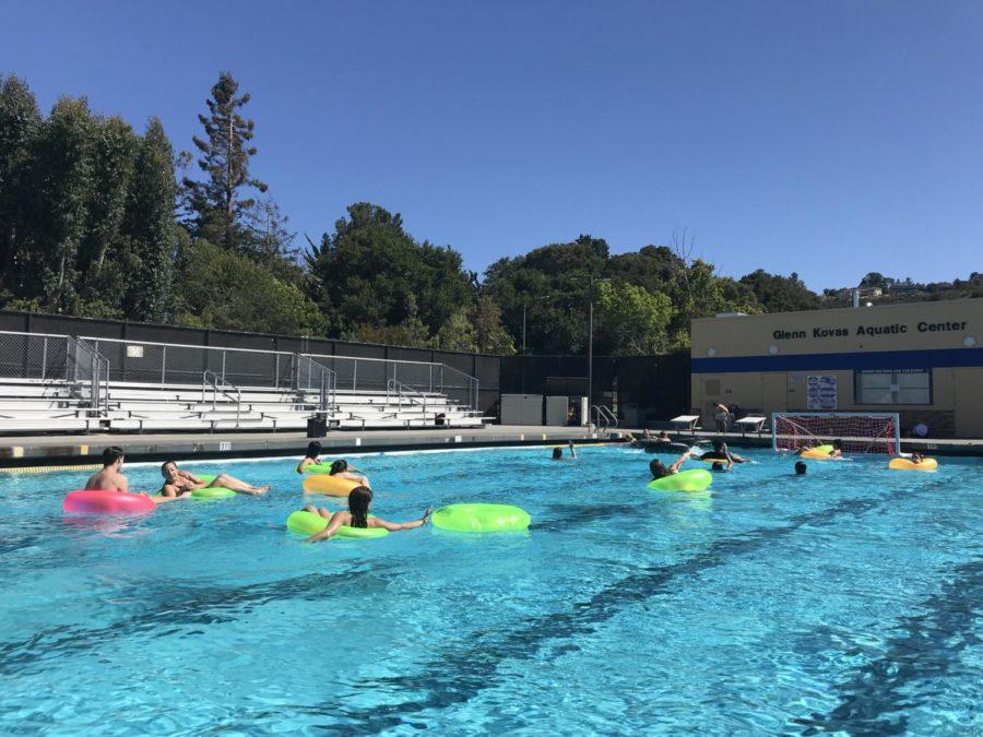 Students in different-colored inner tubes competed against each other in a game.