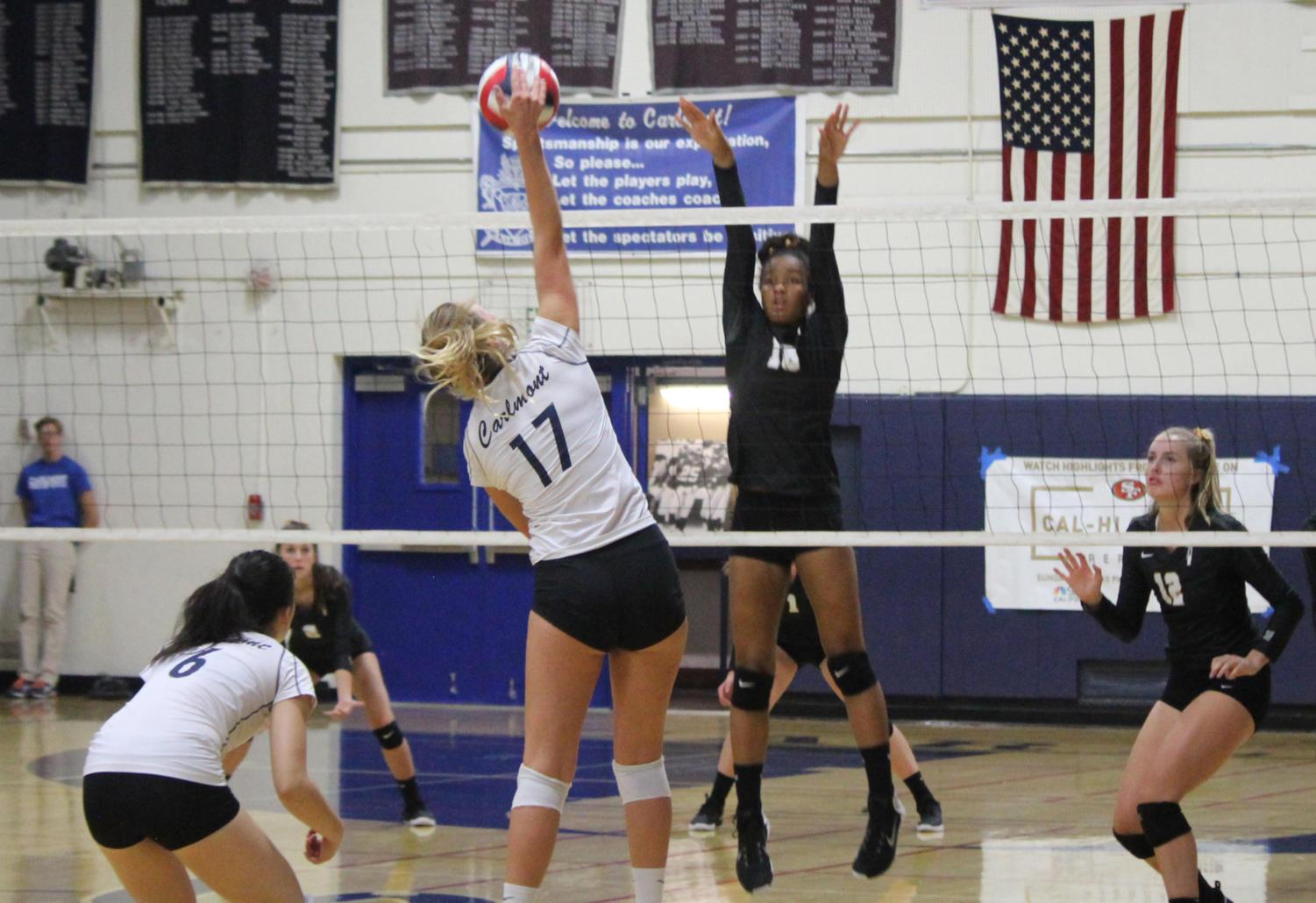 Carlmont senior Elizabeth Prozell spikes the ball in the final set.