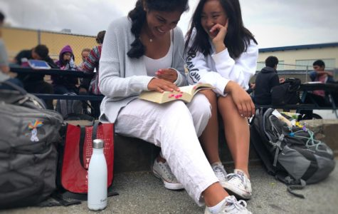 Juniors Soni Kanaya and Chloe Palarca-Wong eat lunch in their all white Spirit Week gear.