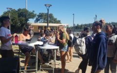 Students buy Juniorfest tickets during lunch.