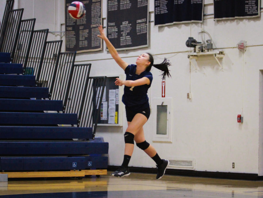 Megan Kwong, a freshman, serves a ball over to Burlingame's side of the court.