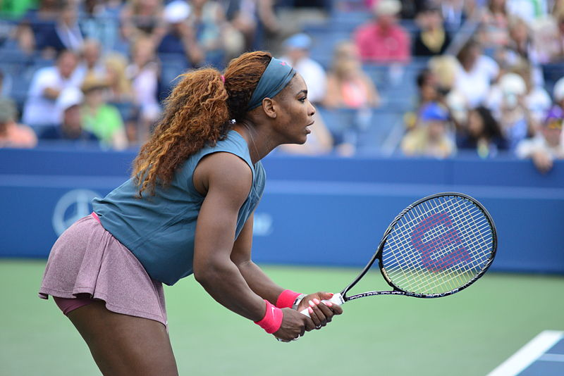 Serena Williams gets into position at the 2013 U.S. Open. Williams was recently in the news for getting into a verbal argument with the umpire, Carlos Ramos, at the 2018 U.S. Open.