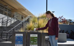 Alice Chamberlin, a junior, uses the tri-bins to throw her thrash away. With the tri-bins now on campus, many students are eager to throw their trash away in the correct spot.