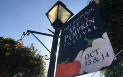 A Half Moon Bay Art & Pumpkin Festival banner advertises the celebration.