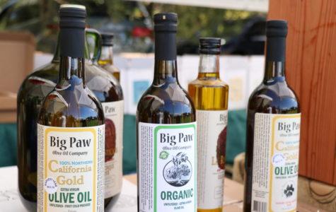 Vendors sell olive oil at Olive Festival in Fremont.