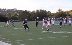Running Back Dane Fifita, a freshman, puts a move on a Woodside defender, fighting for extra yards.