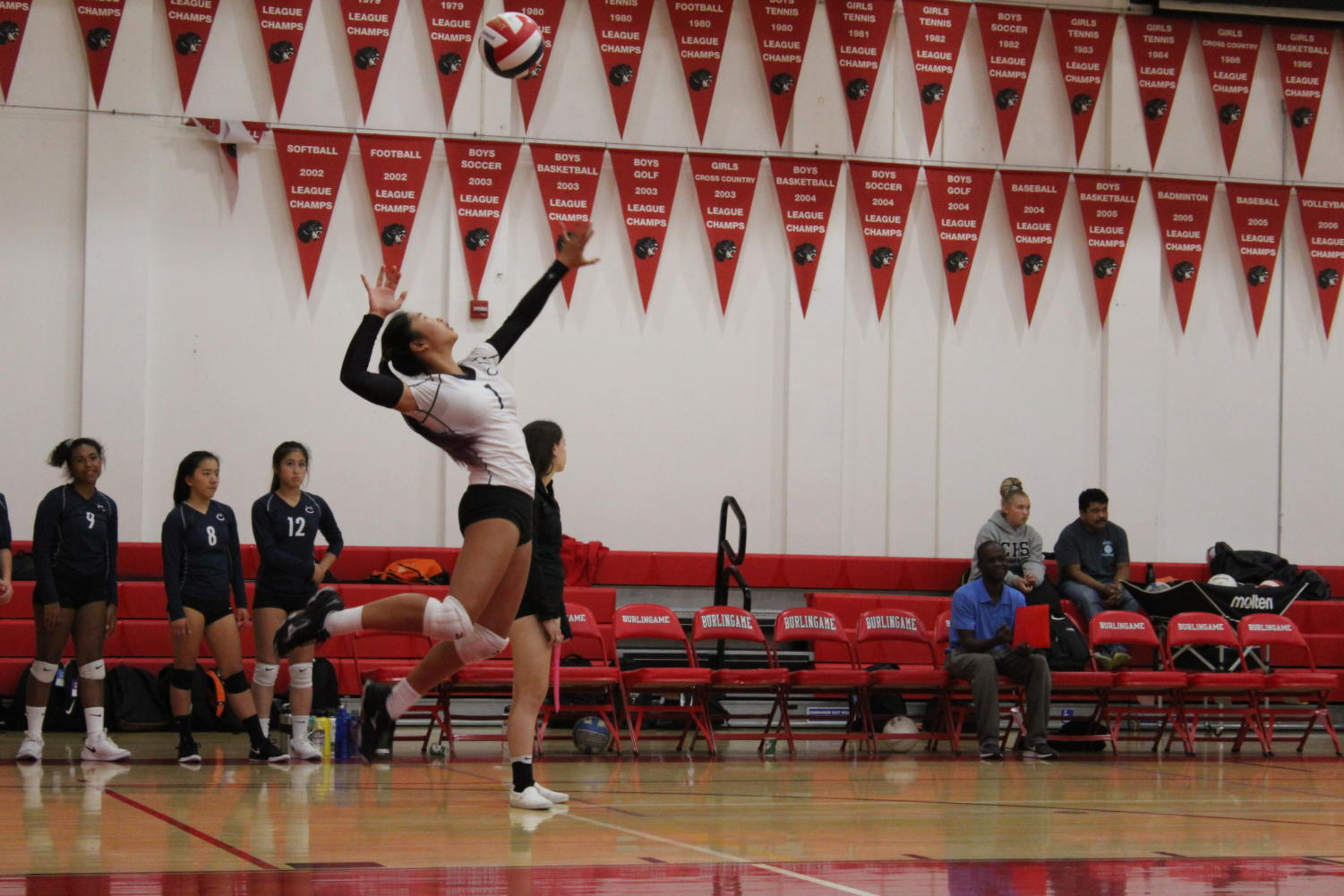 Freshman Jordan Yee serves the ball in an attempt to win a point for the Scots during the first set.