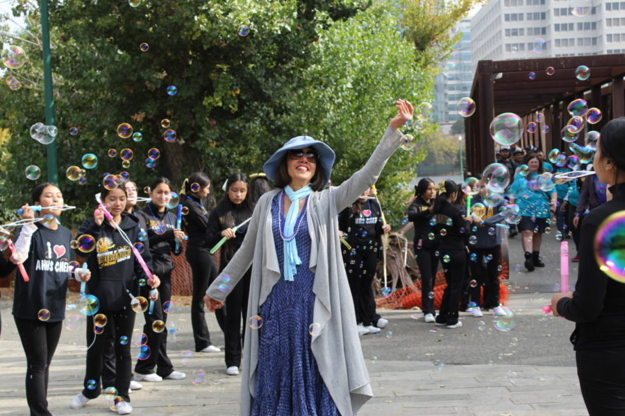 A walker celebrates in the isle of bubbles.