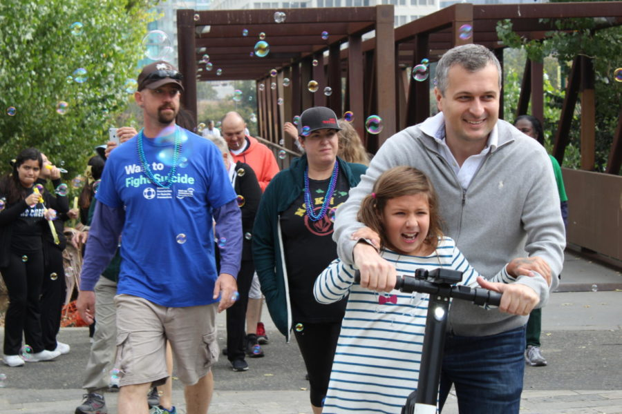 A family rides through the end of their walk with excitement.