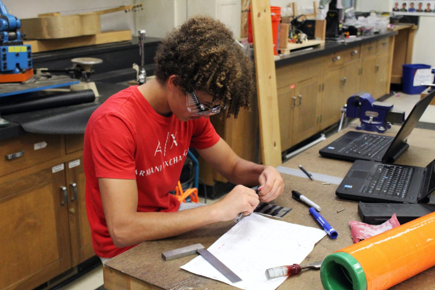 Abdel Zaro, a sophomore, designs a part for the robot.