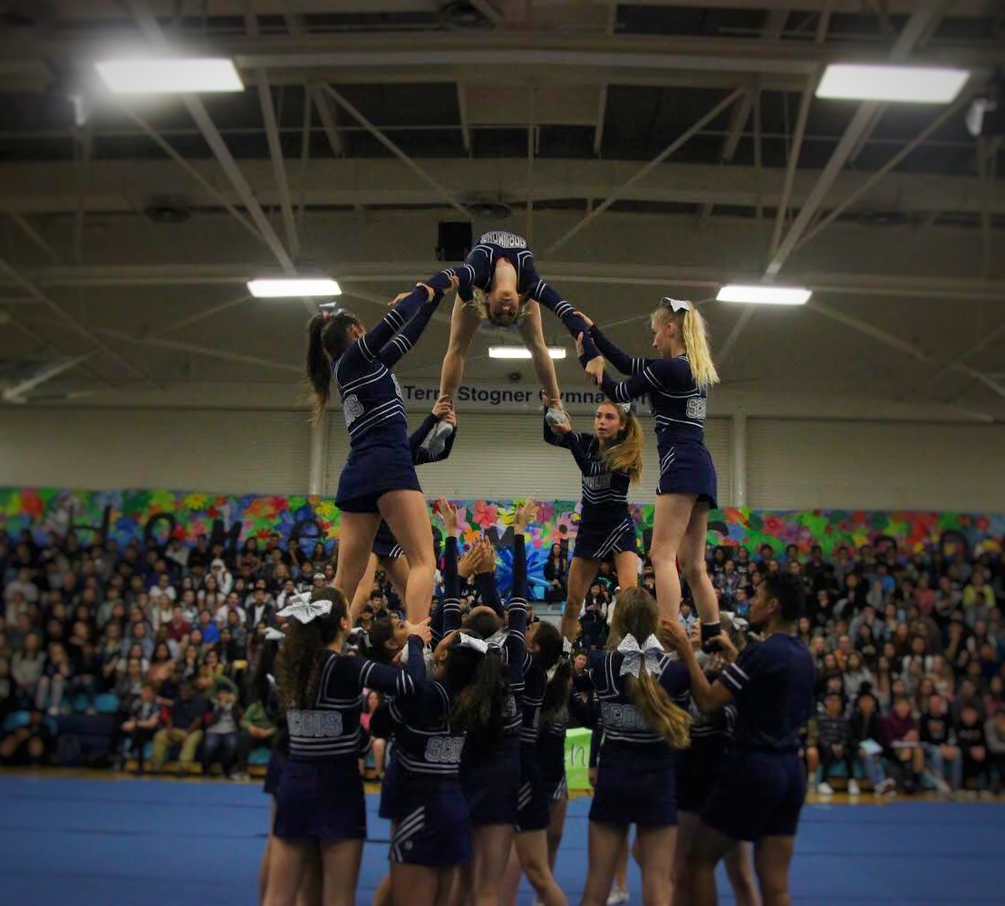 Carlmont cheer shows off one of their new stunts in the homecoming assembly.
