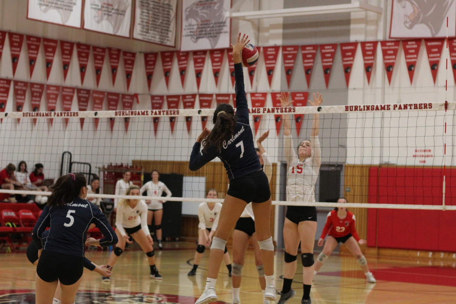 Alisha Mitha, a junior, spikes the ball against the Burlingame Panthers in the fifth set.