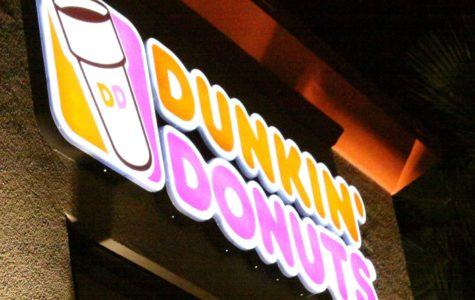 The store's neon sign glows before sunrise on opening day.