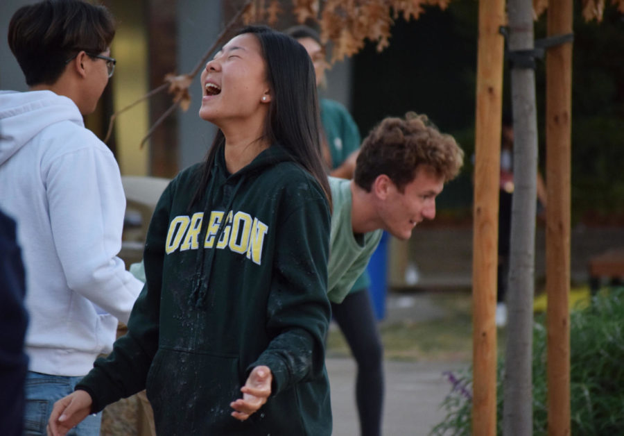 Allison+Uozumi%2C+a+sophomore%2C+laughs+hysterically+as+she+is+drenched+from+a+popped+water+balloon.+