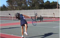Vienna Huang, a sophomore, returns a serve while warming up.