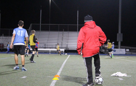 Coach Jose Cabellero actively runs drills for the team during practice.