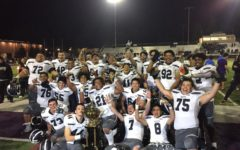 The varsity football game celebrates their history-making victory after years of losing to their rival, Sequoia.