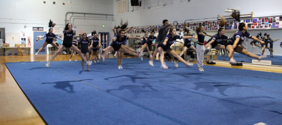 The+cheerleaders+work+on+the+straddle+jump+of+their+routine.