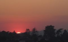 A red sun and hazy skies were the dominant signs of the Camp Fire raging some couple hundred miles away from Carlmont High School.