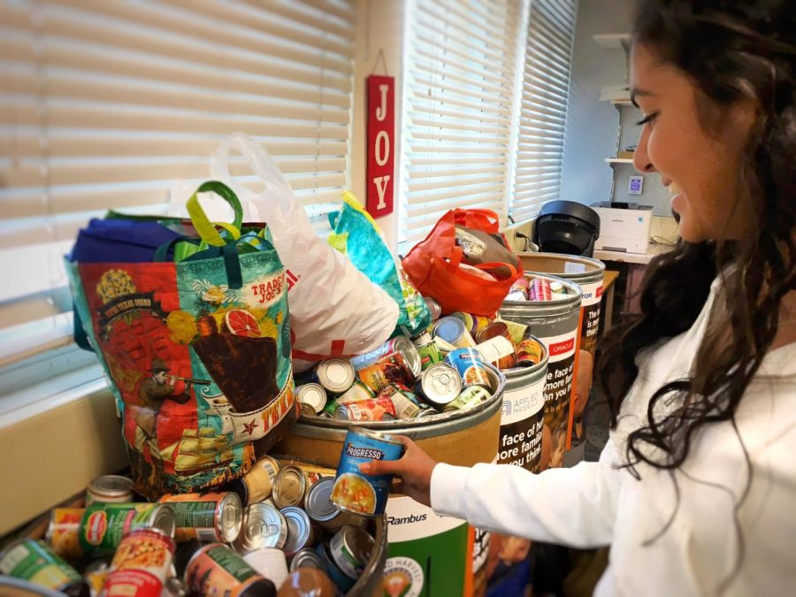 A collection of events that ASB has accomplished this year. Soni Kanaya, a junior and member of ASB, organizes and prepares the canned food donations for collection.
