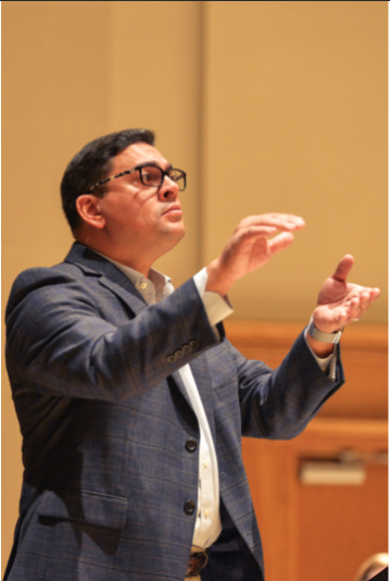 Director of the womens choir and Director of Choral & Vocal Studies at California State University Angel Vázquez-Ramos conducts a song.