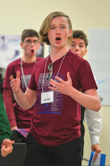 Nate+Peters+sings+with+the+men%27s+choir.