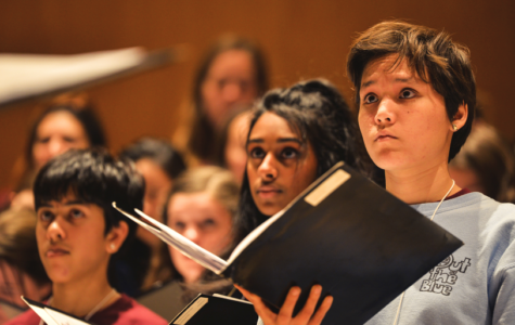 Amelia Espinosa, a senior, practices with the women's choir.